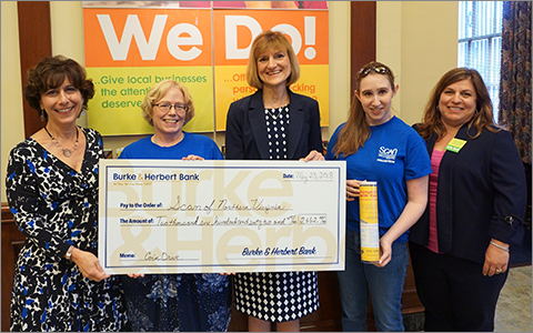 Burke & Herbert Bank representatives present a $2,600 check for the 2018 Coin Drive to SCAN of Northern Virginia representatives at the Bank's historic Main Office. From left to right are: B&HB Vice President Jane Petty, SCAN Director of Development Sally Richards, B&HB Executive VP Terry Cole, Samantha Hagenow of SCAN, and B&HB Main Office Branch Manager Ann Marie Moore.