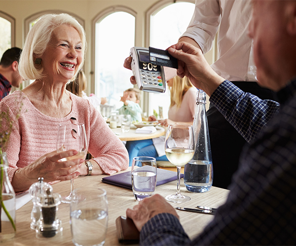 Couple Paying at Restaurant
